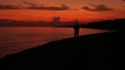 Man jogging at the evening next to seaside