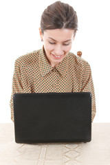 woman in shirt sitting and using laptop for online chat