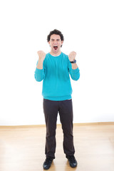 Young man screaming with clenched fists