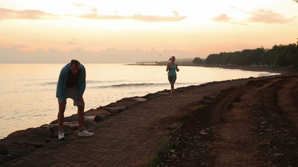 Couple jogging together in the morning in exotic place