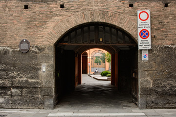 Side door of Accursio Palace, Bologna, Italy