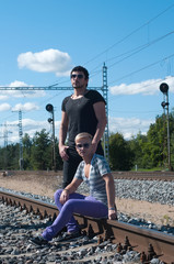 Two young attractive guy on rails