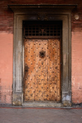 Old medieval wooden door, Italy