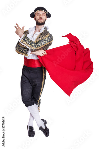 Leinwandbild Motiv Male dressed as matador on a white background