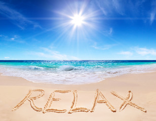 "word ""relax"" on the tropical beach"