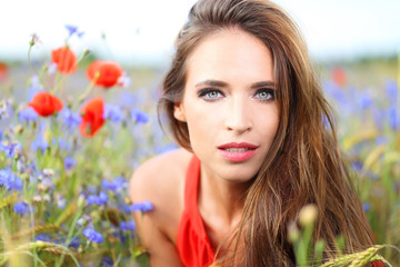 Cute woman on flower field