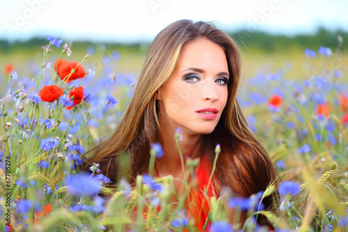 canvas print picture Cute woman on flower field