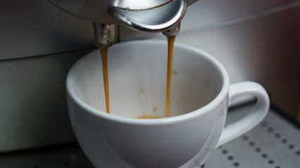 Coffee Machine Making Espresso into a Cap, closeup