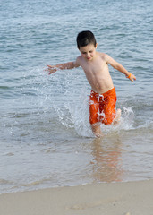 Child in sea on beach