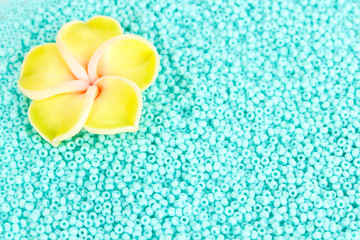 Green beads with decorative handmade flower closeup