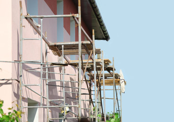 Construction of building of new two-story  house with stairs