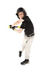 young baseball player swinging bat with eyes open