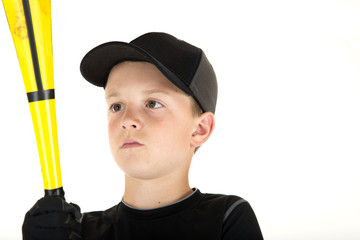 young boy baseball player looking at his bat