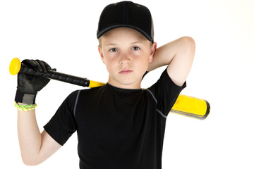 Young boy baseball player holding his bat with a serious express