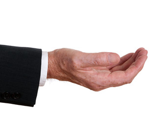 Senior businessman hand outstretched - asking or offering. White