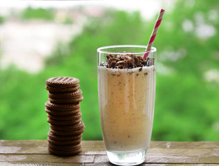 Milk cocktail in glass and chocolate cookies