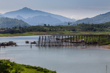 morning at  wooden bridge in thailand