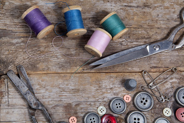 Vintage Background with sewing tools,  buttons and colored tape