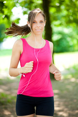 Young woman running at the park