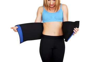 Fit woman with belt for weight loss