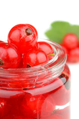 Delicious raw fresh red currant berries in a small jar