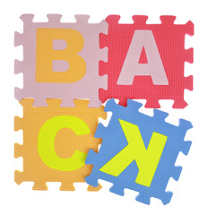 "Word ""Back""  jigsaw puzzle pieces isolated on white"