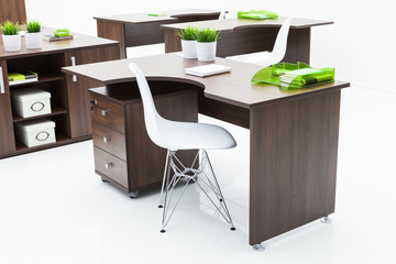 wooden desks and white chairs