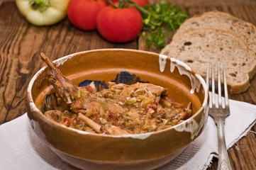 Rabbit stew served in romanian traditional earthenware