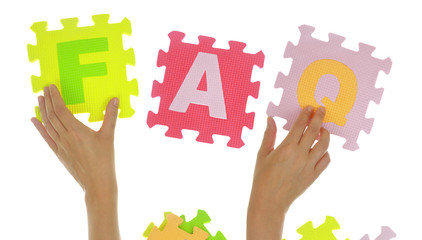 "Hands forming word ""Faq"" with jigsaw puzzle pieces isolated"