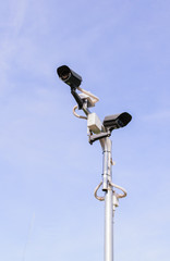 CCTV security camera on  blue sky
