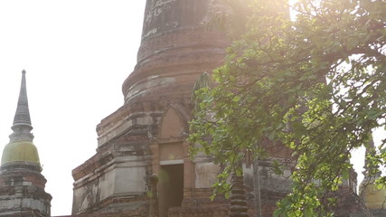 Very old Pagoda or Stupa of Ayutthaya Thailand with sunlight