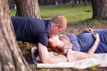 Pregnant couple man husband woman girl wife in love outdoors, hu