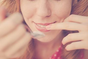 Beautiful Pin-Up Girl eating ice cream, close up