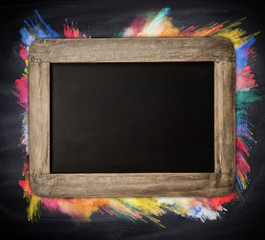 Blank blackboard with colored powder