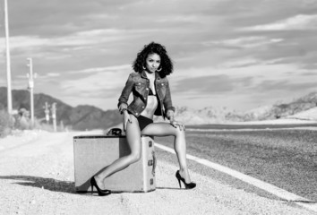 woman suitcase wearing bikini denim jacket desert