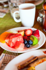 Breakfast with fresh fruits and coffee