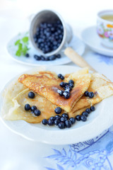 Delicious homemade crepes with blueberries and honey.