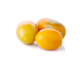 Three yellow tomatoes