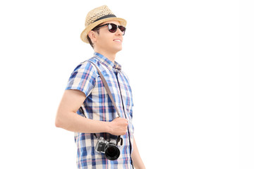 Profile shot of a male tourist walking