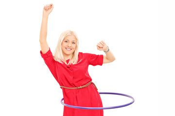 Woman exercising with a hula hoop