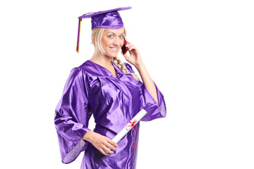 Woman in graduation gown talking on the phone
