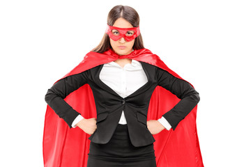 Woman in superhero costume standing proudly