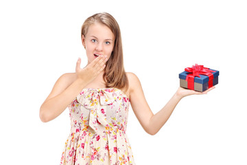 Young girl holding a present