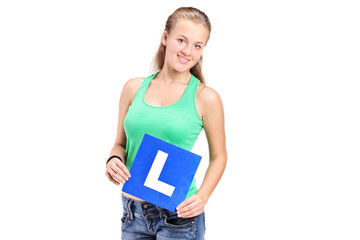 Young girl holding a L sign