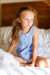 Sweet little girl in light blue pajama