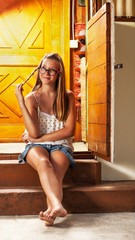 Caucasian girl chilling on wooden house porch