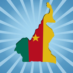 Cameroon map flag on blue sunburst illustration