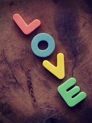 Love on wood background old retro vintage style