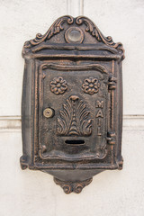 Antique Iron Mailbox on concrete wall