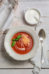 Tomato soup with cheese, basil and cream
